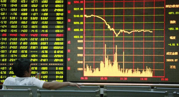 A Chinese investor checks share prices