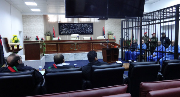 Local and international interest in the trials of Qaddafi-era figures has waned amid ongoing issues regarding transparency, access, and legal representation.