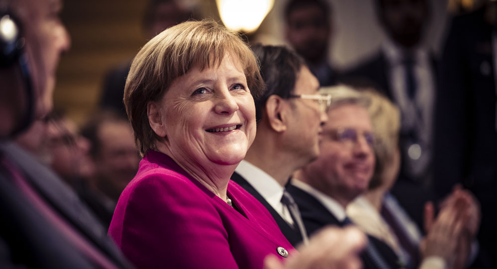 Merkel Comes to Town, and How