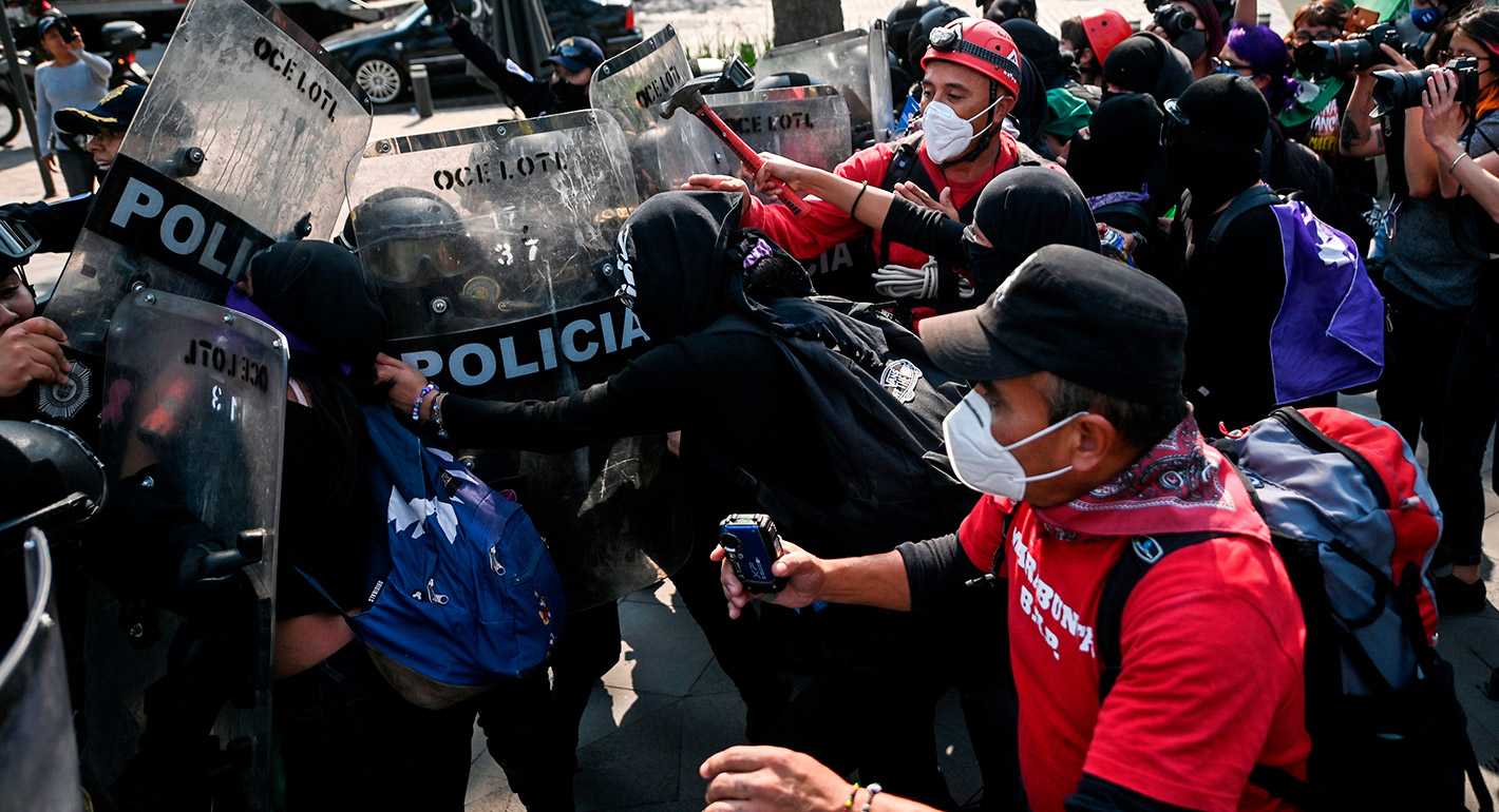 Activists women clash with riot police during a demonstration in Mexico