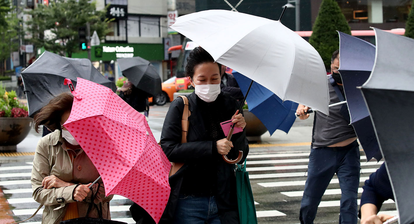 Pedestrians walk in the rain brought by typhoon Haishen on September 07, 2020 in Seoul, South Korea.