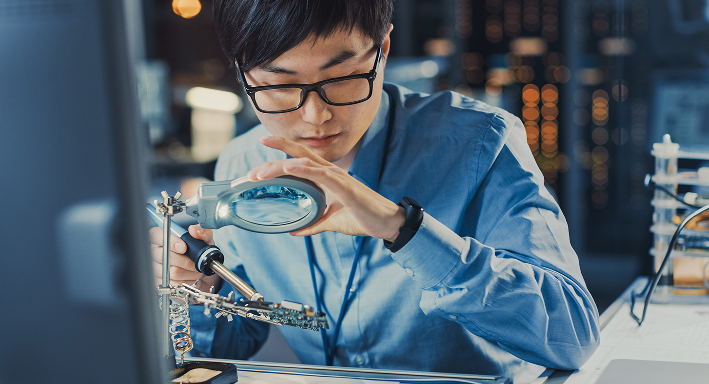 Close Up of a Professional Japanese Electronics Development Engineer
