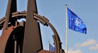 NATO flag in the wind at NATO headquarters