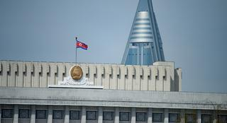 2019 a North Korean flag flies above the Supreme People's Assembly in Pyongyang