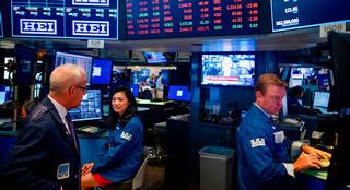Traders react after the closing bell at the New York Stock Exchange (NYSE) on August 5, 2019 at Wall Street in New York City. - Wall Street stocks plunged after a forceful response by Beijing to the latest US tariff announcement escalated an ongoing trade war, exacerbating global growth worries.