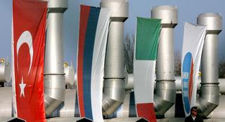 Flags of Turkey, Russia and Italy hang on pipes at the Blue Stream gas pipeline
