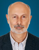 Sayigh is a senior fellow at the Carnegie Middle East Center in Beirut, where his work focuses on the Syrian crisis, the political role of Arab armies, security sector transformation in Arab transitions, the reinvention of authoritarianism, and the Israeli-Palestinian conflict and peace process.