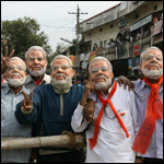 Supporters of Bharatiya Janata Party (BJP) wear masks of Gujarat state Chief Minister Narendra Modi